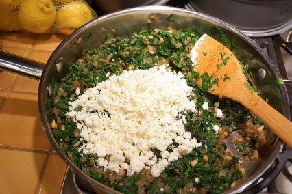 Remove from heat. Cool slightly. Add crumbled feta cheese.