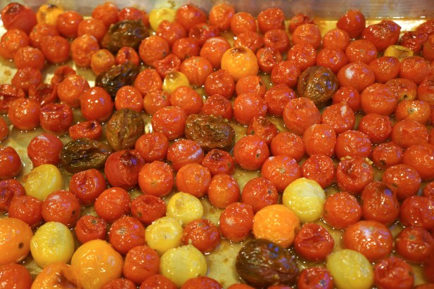 Bake in preheated oven approximately 20 minutes, until some of the tomato skins pop and start to brown.