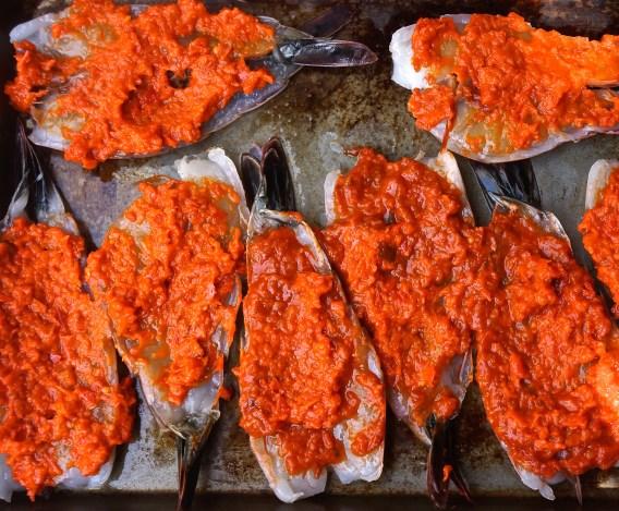 Smear Ajvar spread over each shrimp.