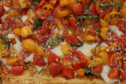 This Mozzarella Tart with Fresh Tomatoes and Roasted Garlic uses store bought puff pastry and is beautiful and simple.