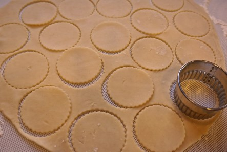 Using 2 3/8-inch cookie cutter, cut rounds and place them in non-stick sprayed mini muffin pans.