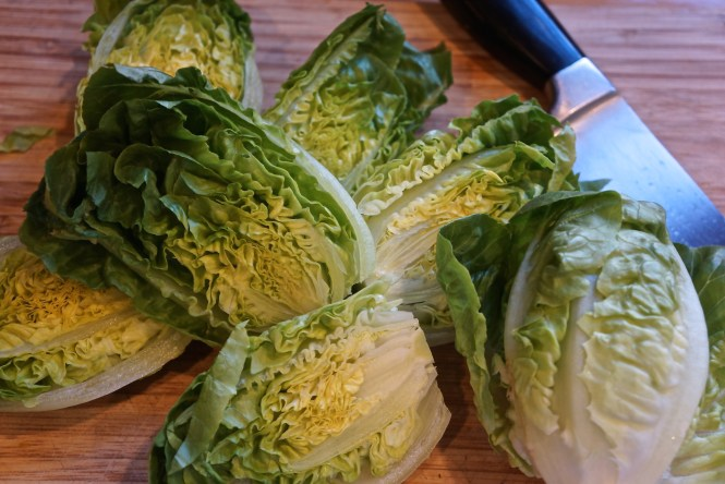 Cut each little gem lettuce in half. Place halves open face in a serving platter.