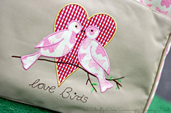 yummy mummy pink lining poppins bag