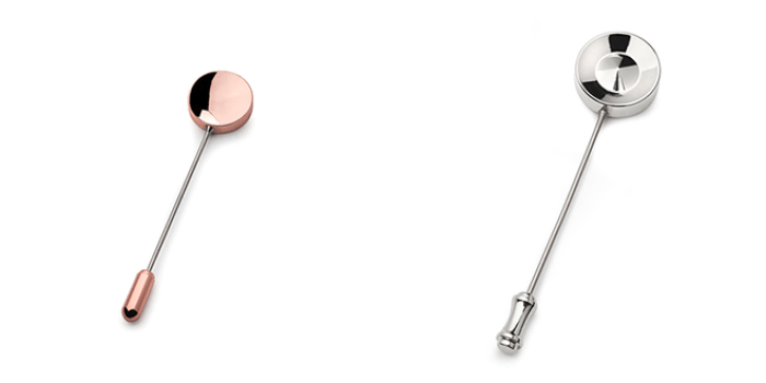 A copper (left) and a silver (right) lapel pin