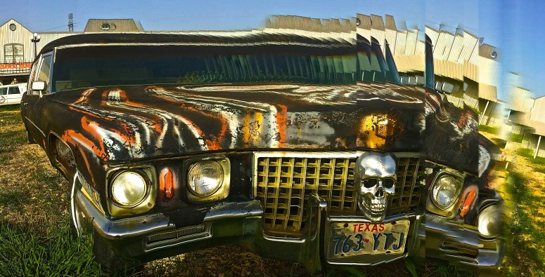 Black Cadillac Hearse front Distorted