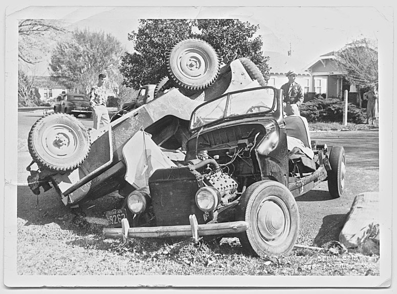old texas Officer Tommy Baxter standing behind an automobile accident 1954 jefferson County