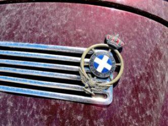 Classic VW convertible in Santorini, Greece, detail emblem