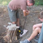 Using the car jack to finish the stump off.