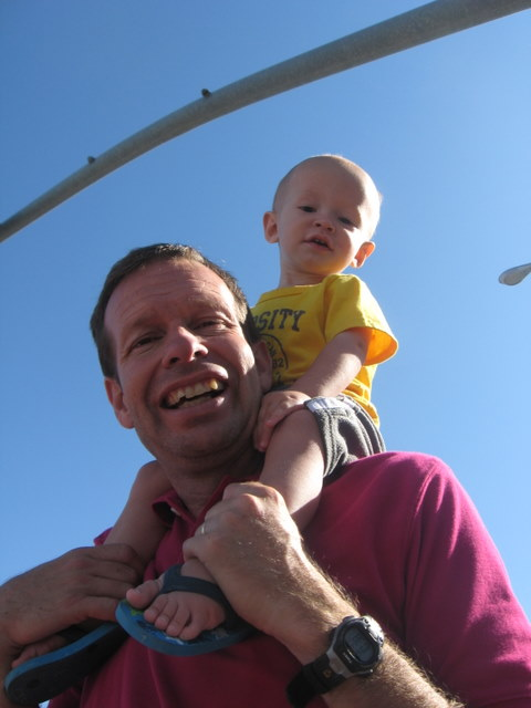 Cooper watcing the parade on my dad's shoulders.