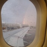 This rainbow out the plane window was a nice end to our trip.