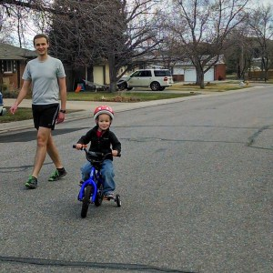 Cooper riding his bike home from the park. He like to lead, but never crosses streets without help.