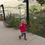 Ellen excitedly running into the Visitor's Center with her new Dora Backpack.