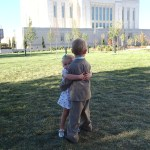 The kids hugging on the temple grounds.
