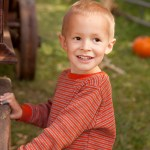 A great shot of Cooper next to an old tractor.