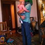 The monkeys climbing all over grandpa.