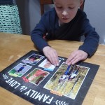 Cooper putting the final piece in the personalized puzzle we gave him for Christmas.