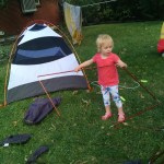 Ellen helping erect a tent for cleaning in the backyard.