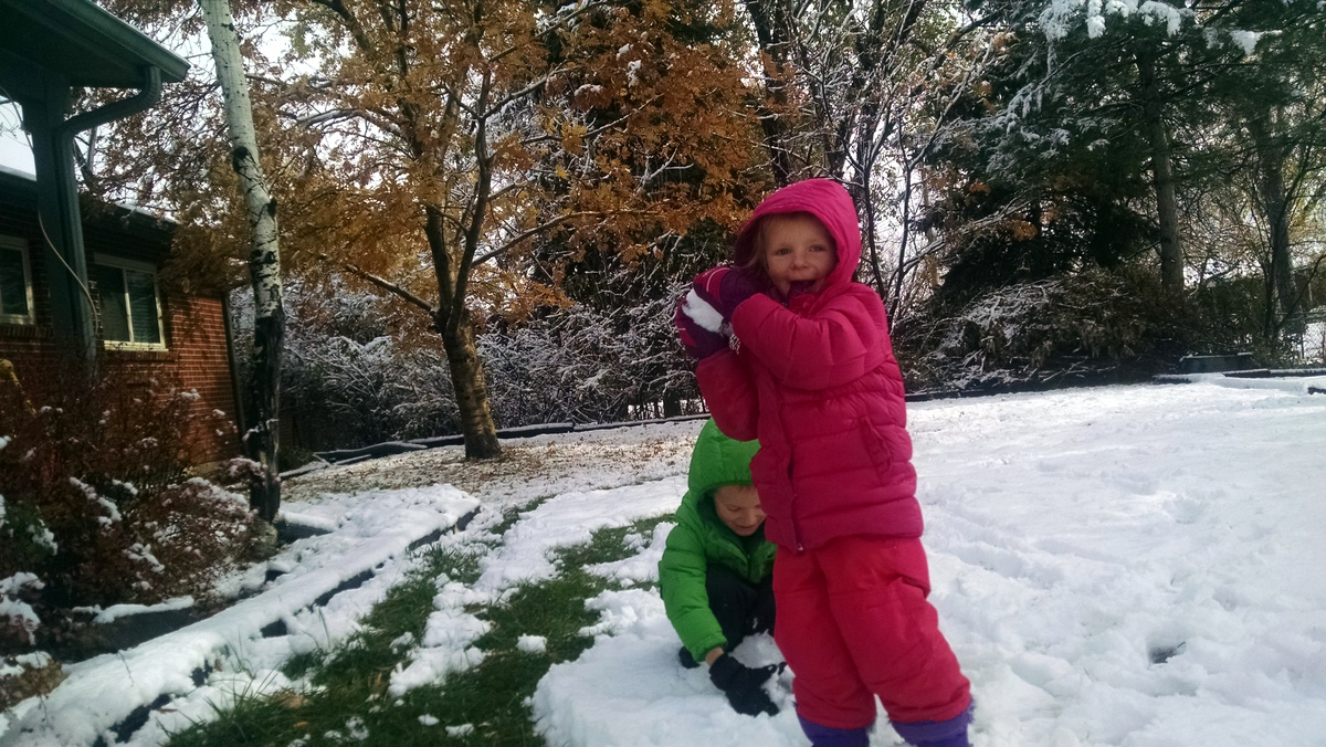 Ellen literally kicked and screamed as I wrestled her into her snowsuit, but in the end I think she decided snow wasn't so bad.