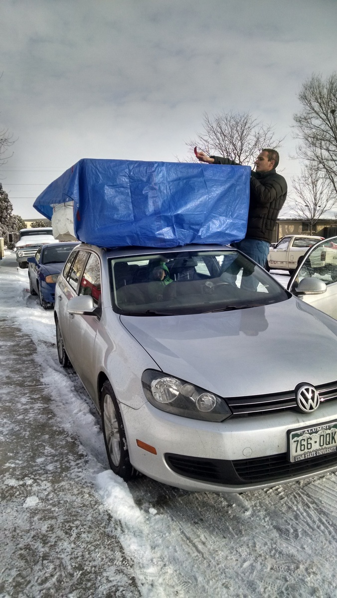 The cat peeing on the guest bedroom futon spurred us to buy an actual mattress for the guest room. Shopping for one on Craigslist was an interesting adventure . . . When we found one we tied it to the roof of our car for transport, naturally.