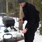 Noel grilling the dogs and heating up the hot cocoa.