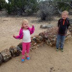 Kids posing near a petrified tree.