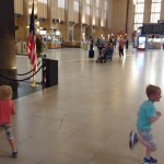 Kids running around the large Penn Station in Philadelphia.