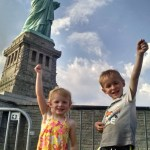 Kids being the Statue of Liberty.