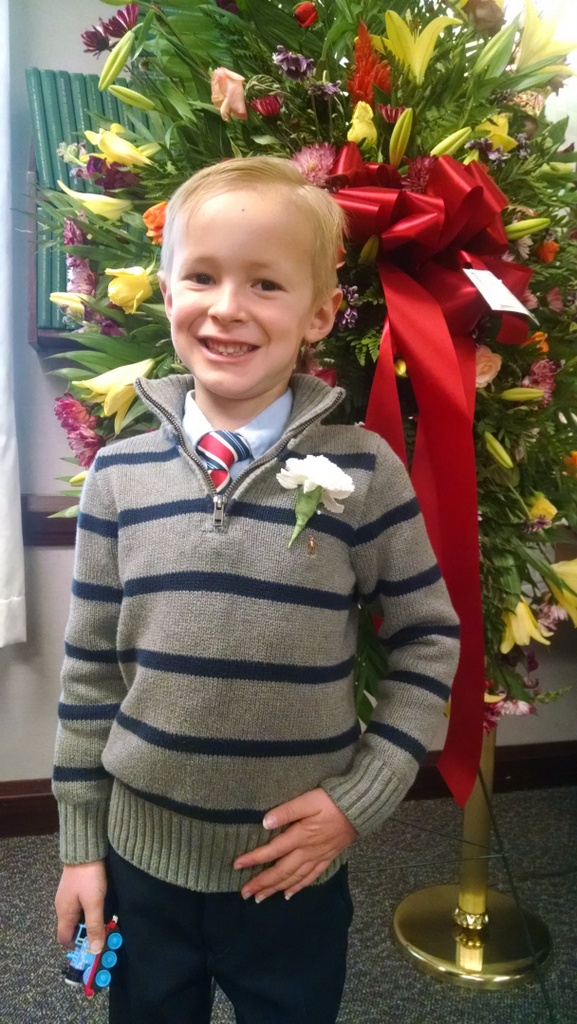 The kids were honorary pallbearers. Cooper looked handsome in his boutonniere.