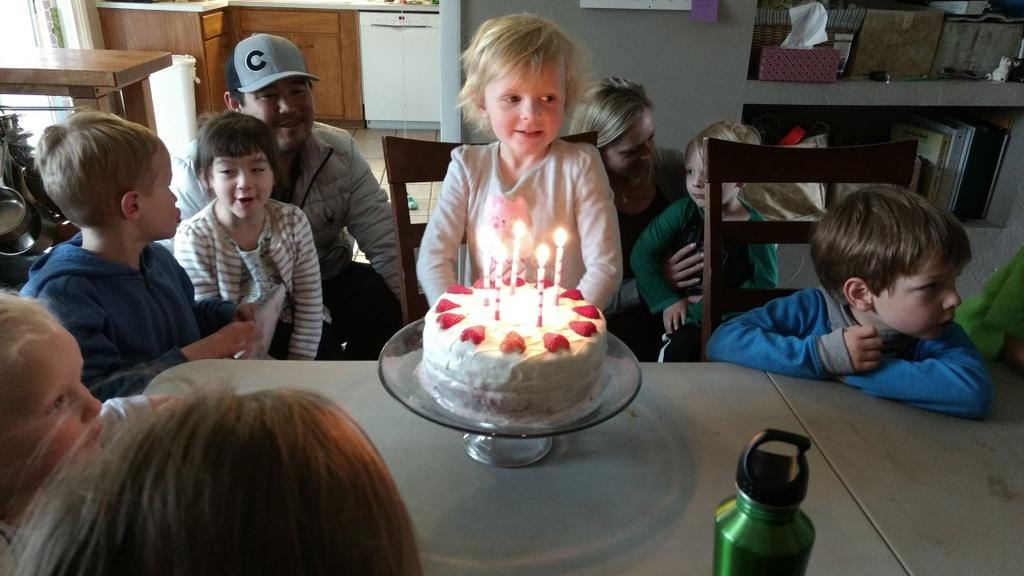 Her friends singing happy birthday.