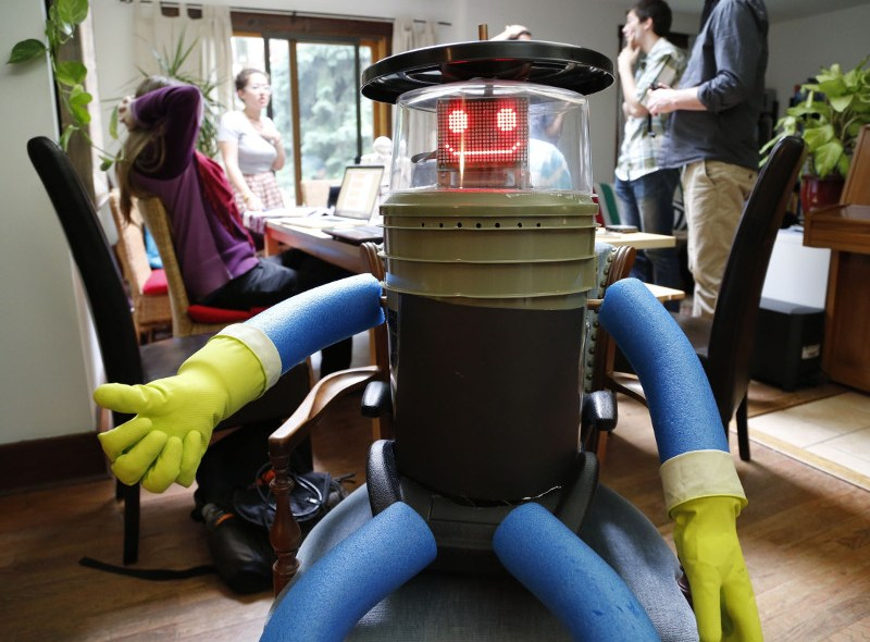 hitchBOT at home with it's research team in Port Credit, Ontario.