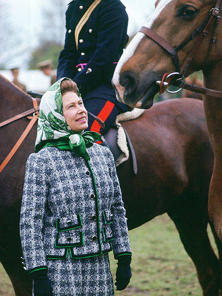 Looking quite the fashionista in her tweed jacket and silk scarf, the Queen loving admires a steed at The Royal Windsor Horse Show, late 1970s. Image Source: Tim Graham / Getty Images.