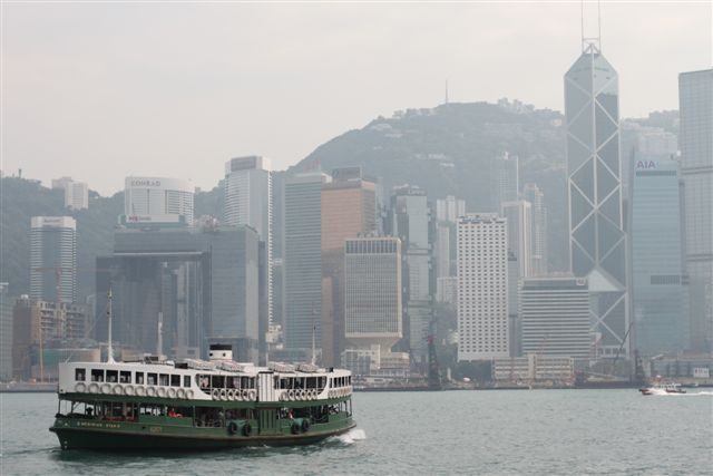 Star Ferry in Front of Hong Kong Skyline