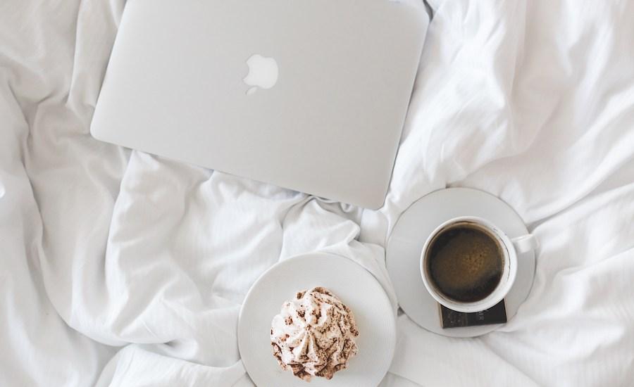 social media marketing laptop bed cupcake coffee