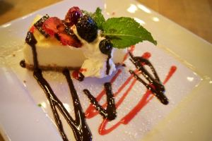 NY Cheesecake with fresh berries at Farmer's Bottega Restaurant in Mission Hills, San Diego