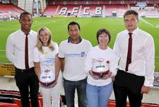Hospice representatives with AFC Bournemouth players Mitchell Nelson and Dan Thomas