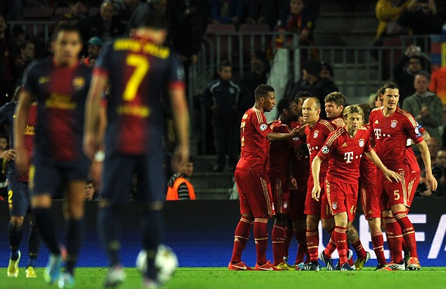 Barcelona players look on as Bayern Munich celebrate yet another goal
