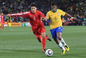 Cha-Jong-Hyok with Brazil's Michel Bastos at the 2010 World Cup