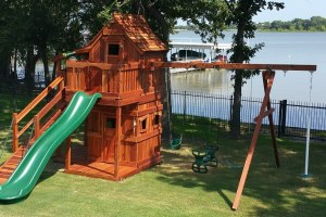 Play Set shown with Mustang 7', Upper Cabin with Gable and Eave Doors, Fun Deck, Lower Cabin, Half Shack 6', Lower Floor Kit under Fun Deck, Adventure Ramp, 4 Position Swing Beam, Rave Slide, Infant Swing, Belt Swing, Air Pogo, Glider, Binoculars, Ships Bell