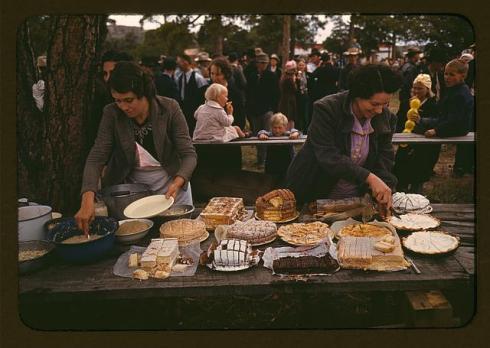 Serving desserts at the Pie Town fair.