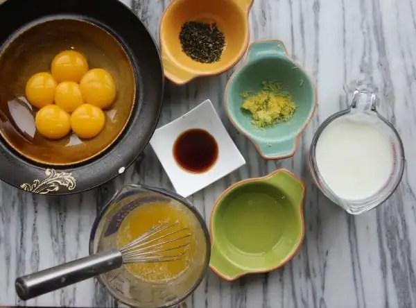 Fluffy Lemon-Rosemary Layer Cake with Lemon Cream Cheese Frosting- Baker Bettie