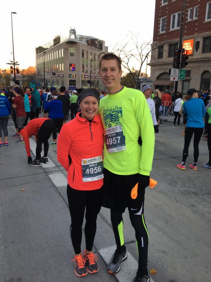 Kayla + her husband before a recent half marathon!