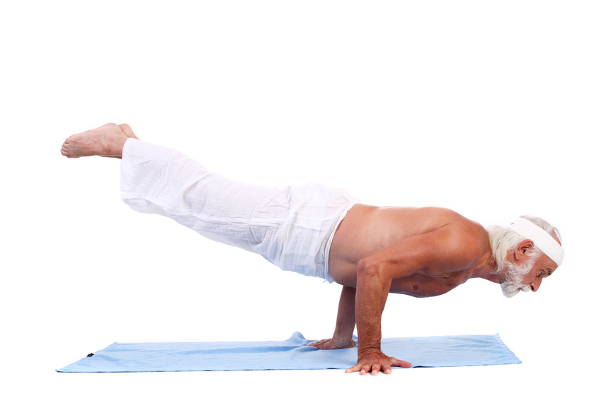 Old grizzled man doing yoga. Isolated over white background.