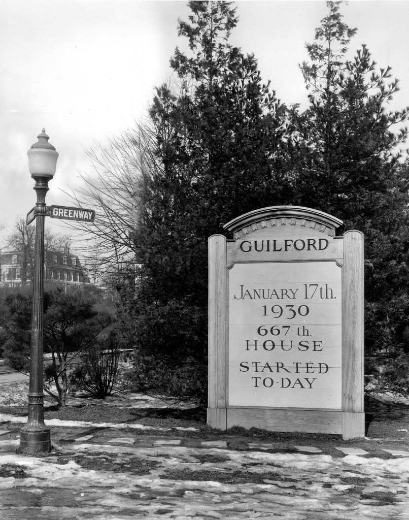 Sign highlighting the groundbreaking of the 667th house in Guilford, January 17, 1930. Courtesy Johns Hopkins University Sheridan Libraries,  Roland Park Company Papers.