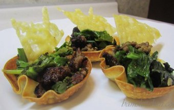 Italian Sausage and Gailan baked in a wonton cup