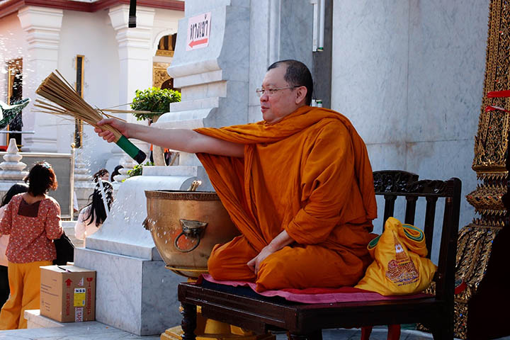 Monk blessing with holy water