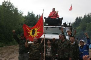 Warriors pose in front of seized truck on July 27th. Photo by Miles Howes