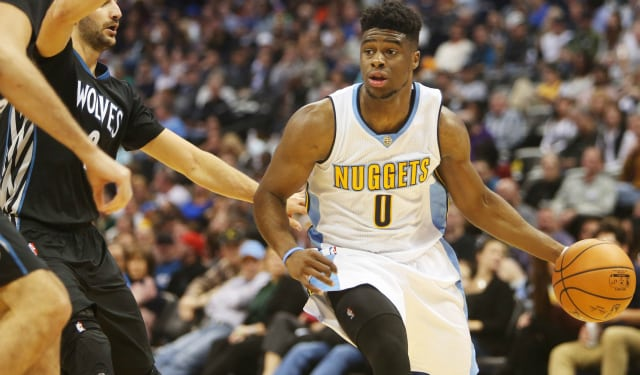 Oct 30, 2015; Denver, CO, USA; Denver Nuggets guard Emmanuel Mudiay (0) dribbles the ball during the second half against the Minnesota Timberwolves at Pepsi Center. The Timberwolves won 95-78. Mandatory Credit: Chris Humphreys-USA TODAY Sports