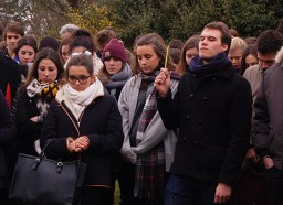 One student raises his pen in solidarity with the murdered journalists