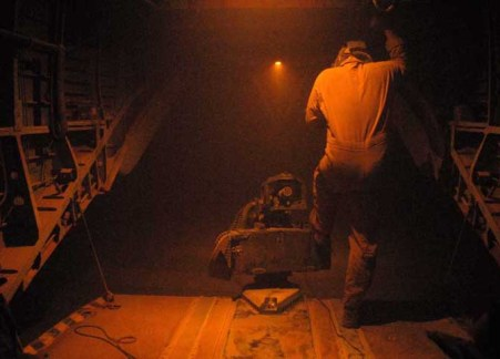 A crew member with Marine Heavy Helicopter Squadron 363 shields himself from a sandstorm on their grounded CH-53 helicopter at Camp Dwyer, Afghanistan, on May 4, 2010. The crew was forced to shut down helicopter and abort their mission for the night after high winds and sand began to interfere with flight instruments, including the electrical generator.  Thomas Brown/Staff