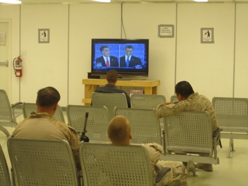 Marines watch the U.S. presidential debate live early Thursday morning at Camp Bastion, Afghanistan, as former Massachusetts Gov. W. Mitt Romney and President Barack Obama tackle political issues.